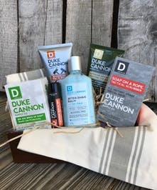 Gift basket filled with men's soap and care supplies.