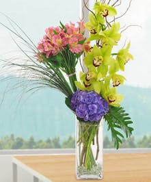 High Style Glass Vase of Alstromeria, Cymbid Orchids and Purple Hydrangea