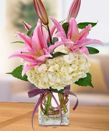 Simple vase of roses, stargazers and hydrangea