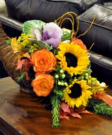 Cornucopia filled with gerbera daisies, roses and lilies