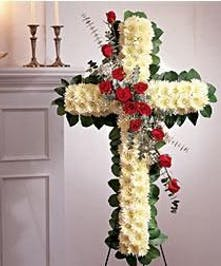 Floral cross tribute made of roses, cushion mums, greenery and more.