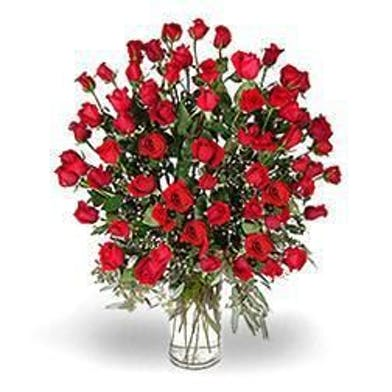 Five dozen red roses in a glass vase.