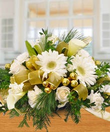 White holiday centerpiece with gold ribbon accents