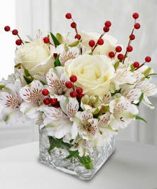 Glass Cube designed with white Roses and Alstroemeria with red berries