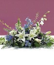 Hanukkah centerpiece of blue and white flowers and greenery