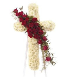 Floral cross tribute made of roses, cushion mums, greenery and floral accents.