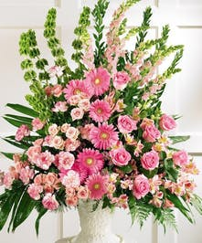 Sympathy urn arrangement of all pink flowers including roses, gerbera daisies, carnations, snapdragons and alstroemeria.
