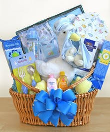 Woven basket filled with items for a newborn baby boy.