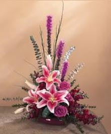 Stargazer lilies and other complementary flowers in a unique presentation.