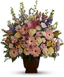 Sympathy arrangement in shades of pink, purple and white.