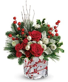 Frosted glass vase with berry accents filled with red and white flowers.