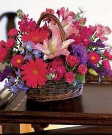 Basket of lilies, gerbera daisies, button poms, alstroemeria, mini roses and more.