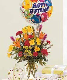 Featuring bright mixed flowers & a mylar balloon!