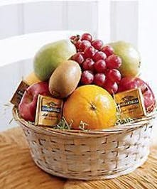 Basket filled with fresh fruit and chocolate.