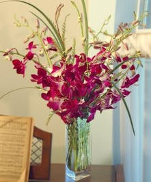 Dendrobium orchids with Italian ruscus accents.