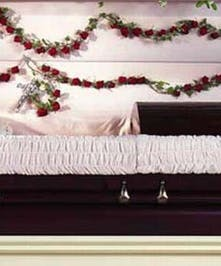 Casket rosary made of 53 red roses and ivy.