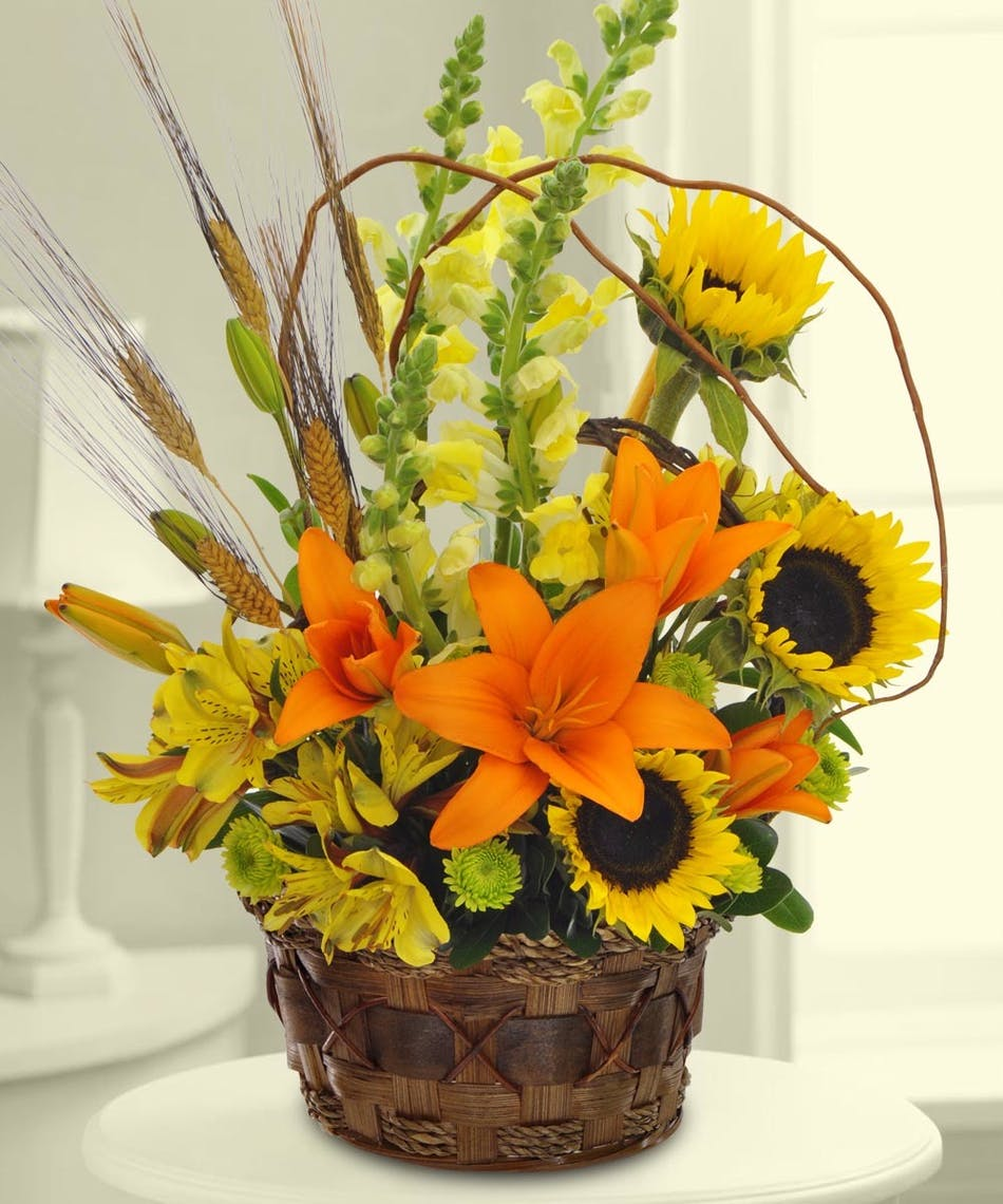 Lilies, sunflowers and more in a garden basket.