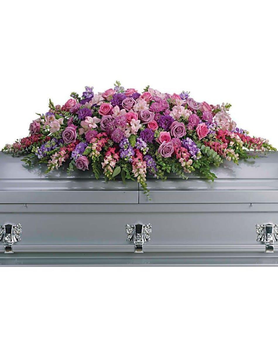Purple sympathy casket spray naples funeral flowers izmirmasajfo