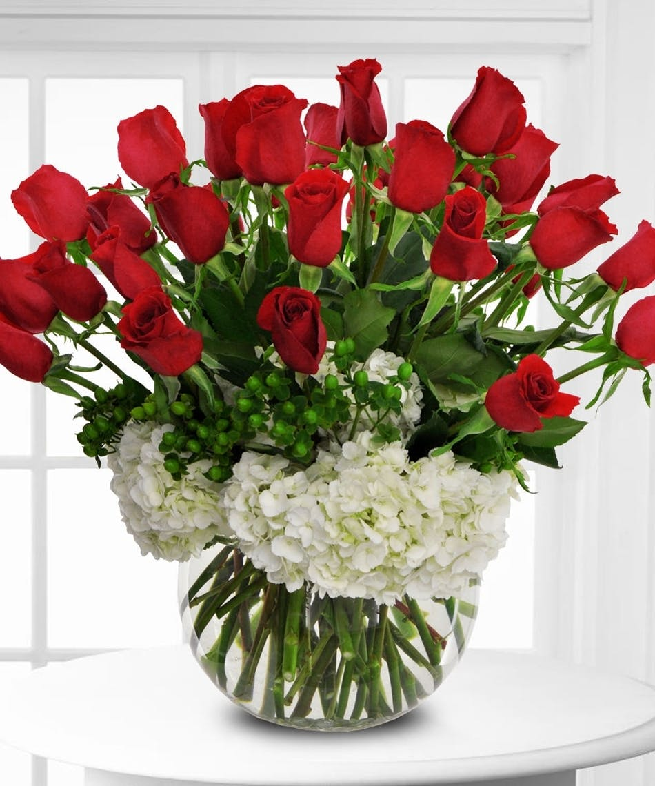 Large vase of white hydrangea and red roses, a true Lux design